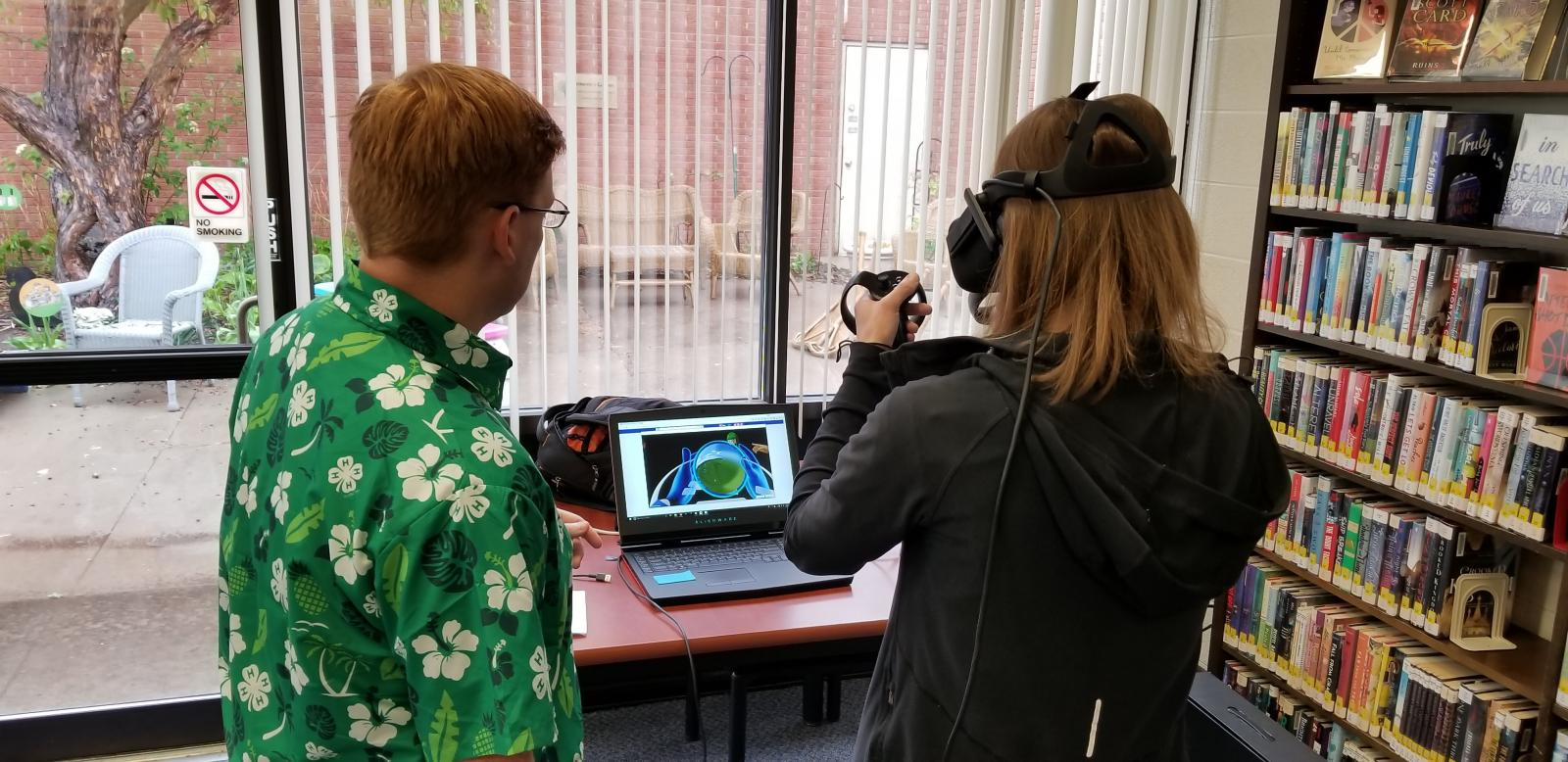 Two participants learn about VR